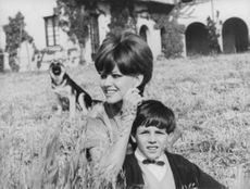 Claudia Cardinale enjoying leisure time with her son and her pet.