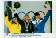 Medalists in downhill skiing Pernilla Wiberg (silver), Katja Seizinger (gold) and Florence Masnada (bronze) at the prize pool during the Winter Olympics 1998