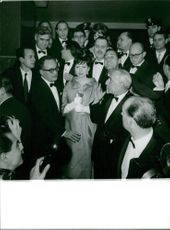 Princess Soraya of Iran and another people gathered for a party.