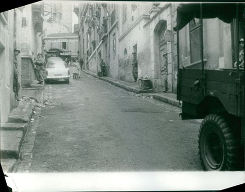 Soldiers standing in an alley.  Taken - Mar. 1962
