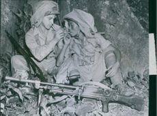 two soldiers smoking under the tree. 1944