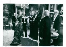 "Michelle Pfeiffer and other casts in a scene from the 1993 American  film, ""The Age of Innocence""."
