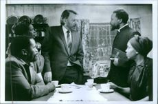Zakes Mokae, Sophie Mgcina, Donald Sutherland, John Kani and Thoko Ntshinga discussing in a scene from the movie A Dry White Season.