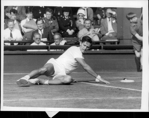 Roy Emerson slipped over in the match in Wimbledon.