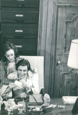 Couple reading a paper.
