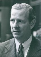James Baker photographed looking at the side. 1984.