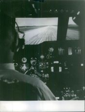 Pilot and co pilot sitting and flying airplane. 1967