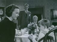 Anita Björk with Alf Kjellin and Olof Winnerstrand together during a scene in film Woman Without A Face. Photo taken in 1947.