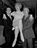 Portrait image of Roy Hudd, Toni Palmer and Danny La Rue at a charity exhibition.