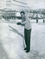 Omar Sharif playing with snow.