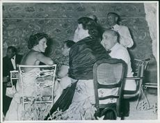 John Spencer-Churchill sitting with people.
