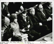Harold Wilson siting with the people in a conference.