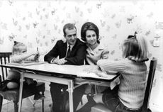Juan Carlos I sitting with his family.
