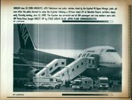 Aircraft Skyjack All Nippon 747 1995: Ambuance and poice vehicles stand by the hijacked.