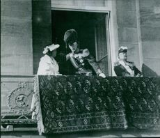 Gustaf V and Victoria of Baden having a conversation on the balcony.