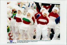 A children's choir performs at the Olympic Stadium during the opening of the Winter Olympics in 1998