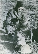 A lieutenant of the U.S. Army forces in Tunisia inspects the graves of five fallen German soldiers. - 1943