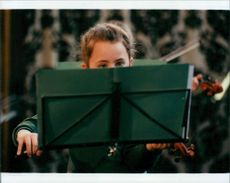 Young violinist taking part in Norfolk County Music Festival.