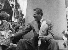 Danny Kaye playing with a child.