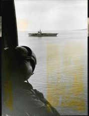 USS Independence hangar ship seen from a submarine jet helicopter