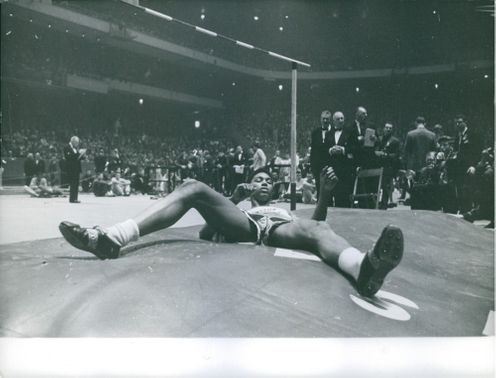 John Thomas lying on the ground after executing the high jump, 1959.