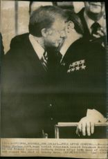 President Jimmy Carter hugs Soviet President Leonid Brezhnev in the Vienna Imperial Hofburg Palace after signing the SALT II treaty