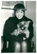 Portrait of Liza Minnelli with dog in his arms