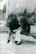 A photo of a man and woman holding their hands. June 3, 1973