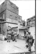 Soldiers roaming the streets during the Algerian War.