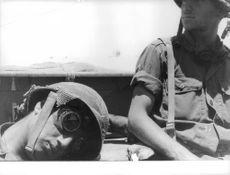Two soldiers in Israel, one is sleeping while the other on look-out.