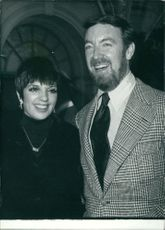 Liza Minelli with her husband Jack Haley Jr., smiling.