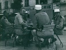 Group of soldier sitting and having conversation.1962