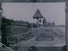 Soldiers standing on their camp in the village.