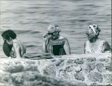 Queen Beatrix, Princess Irene, with Princess Margriet in the water together, 1969.