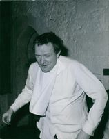 """Richard Harris emerges from the dungeons, somewhat ruffled, after being hurled below for his participation in the """"Lutiny on the Bounty."""" 1953."""