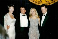 Sylvester Stallone with John Travolta and their wives