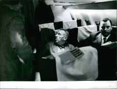 Men sitting in the airplane.