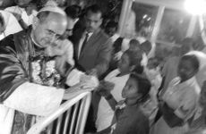 Pope Paul VI meeting people.