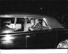 "Robert Francis ""Bobby"" Kennedy's family members sitting in car."