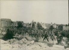 Soldiers marching in the dessert road during WWI, 1916.