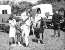 Caroline Bouvier Kennedy riding outdoors.