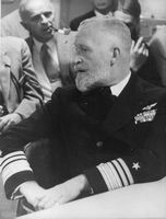 US Navy officer looking away.