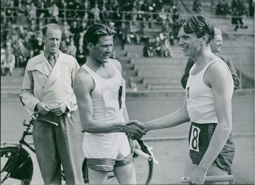 Swedish middle distance runner Arne Andersson being congratulated by a competitor racer after victory of the race in 1940 at Kalarne