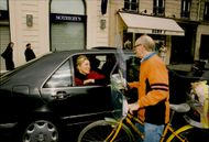 Actress Sharon Stone, who is on his way to the airport after a shopping trip in Paris, is seen here staying to talk with a fan