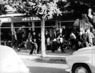 People were running and police officers chasing someone in the city at broad day light.  The Café Wars took place during the Algerian War, as a part of the internal fighting in France between two rival Algerian nationalist movement