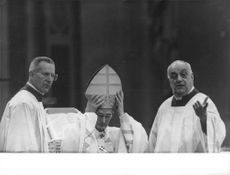 Pope Paul VI with two priests.