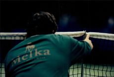 One of the online judges will fix the net before the tennis match starts at Stockholm Open.