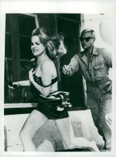"Carroll Baker running away from man. On set ""Station six """