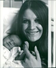 Sandie Shaw with her newborn baby.