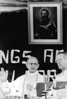 Pope Paul VI talking to a man.